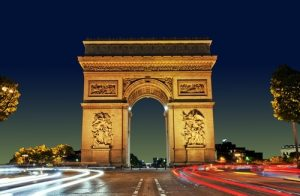 """The Arc de Triomphe (in English: """"Triumphal Arch"""") honours those who fought and died for France in the French Revolutionary and the Napoleonic Wars, with the names of all French victories and generals inscribed on its inner and outer surfaces."""